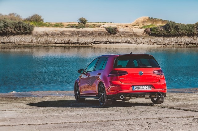 the back of a red VW Golf GTI in front of a lake